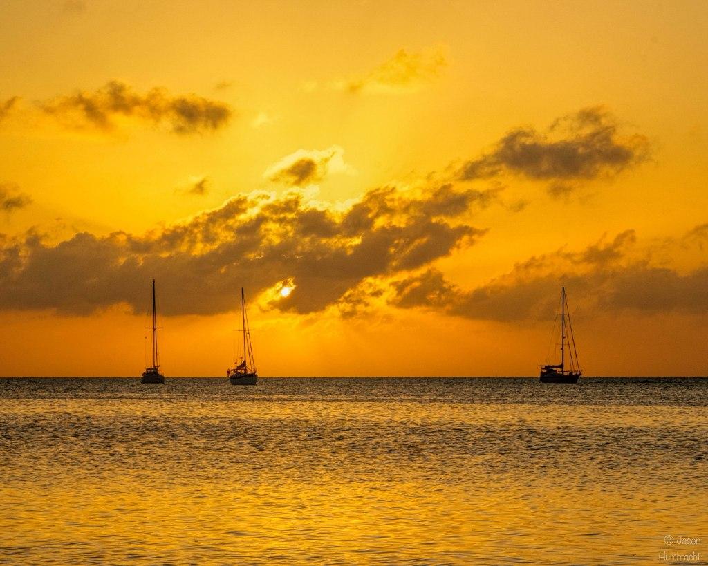 Caye Caulker, Belize Sunset | Sailboat | photo taken by Indianapolis-based Architectural Photographer Jason Humbracht in 2015